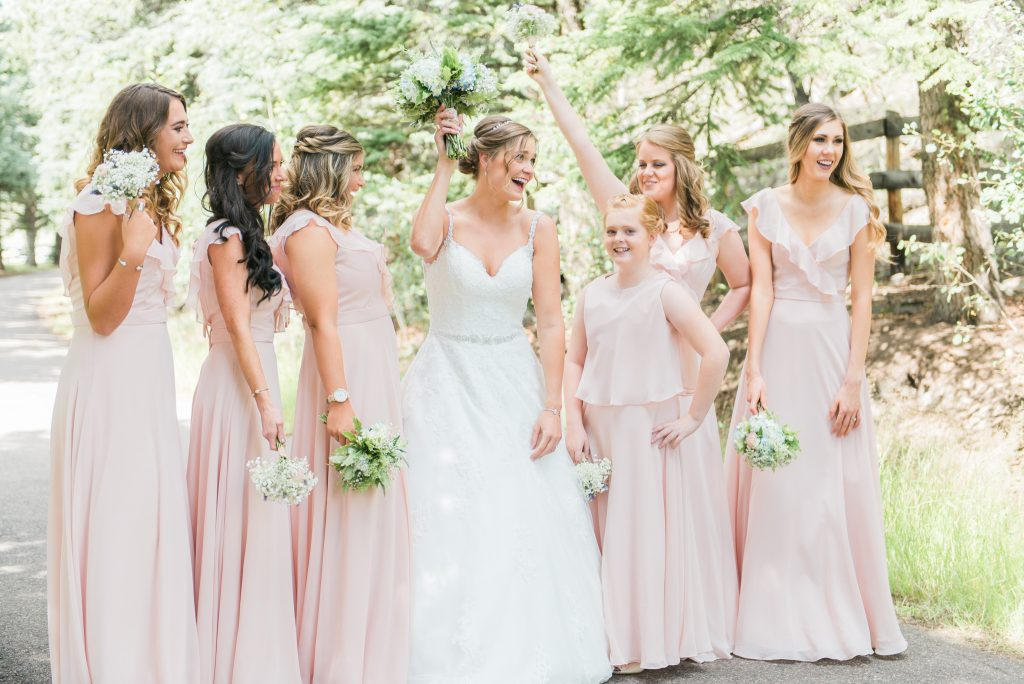 bridal part photos, light pink bridesmaid dresses, light pink wedding party, pink and green wedding colors, wedding party photos, colorado wedding party, colorado wedding photos, outdoor wedding reception, beaded wedding dress, bridal updo, wedding party hair styles, hairstyles for bride, bridal updo, greenery colorado wedding