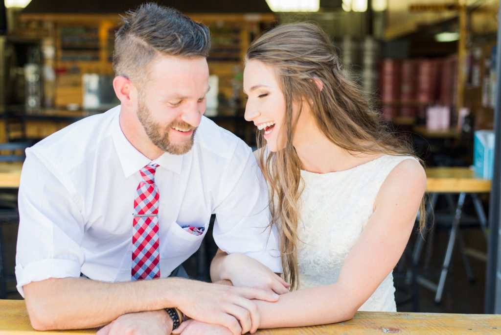 Brewery wedding, simple wedding dress, lace wedding dress, plaid groom tie, red and blue groom tie, colorado themed wedding, half up half down wedding hair, wedding hair ideas, wedding dress ideas, bride and groom portraits, bride and groom wedding photos, happy wedding photos, couple photos, colorado wedding photographer, brewery styled shoot, styled wedding shoot, candid wedding photos