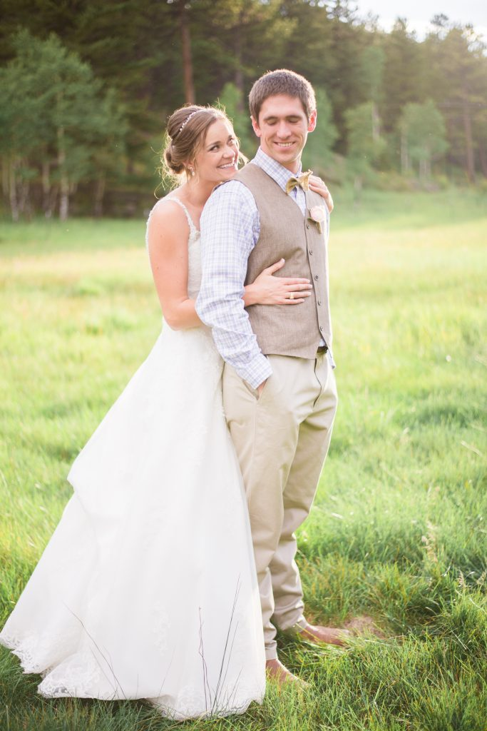 Mountain wedding photos, wedding dress spinning photos, spinning in wedding dress, wedding dress twirl photos, mountain wedding, sunset wedding photos, sunset bridal portraits, bridal portraits, mountain bridal portraits, mountain wedding inspiration, beaded wedding dress, flowy wedding dress, low back wedding dress, rustic wedding inspiration, rustic groomsmen vest, rustic groom vest, tan groom vest, rustic wedding attire, summertime mountain wedding