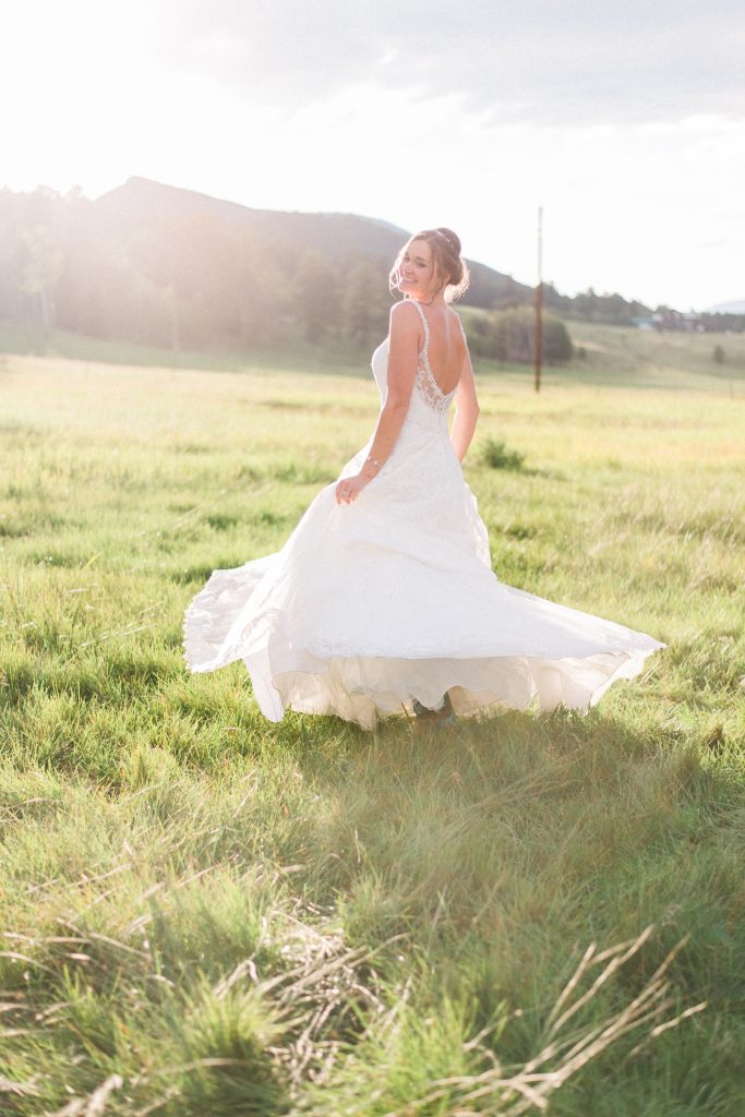 Mountain wedding photos, wedding dress spinning photos, spinning in wedding dress, wedding dress twirl photos, mountain wedding, sunset wedding photos, sunset bridal portraits, bridal portraits, mountain bridal portraits, mountain wedding inspiration, beaded wedding dress, flowy wedding dress, low back wedding dress, summertime mountain wedding