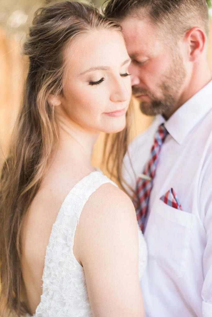 Brewery wedding, simple wedding dress, lace wedding dress, plaid groom tie, red and blue groom tie, colorado themed wedding, half up half down wedding hair, wedding hair ideas, wedding dress ideas, bride and groom portraits, bride and groom wedding photos, happy wedding photos, couple photos, colorado wedding photographer, brewery styled shoot, styled wedding shoot, candid wedding photos, film wedding photos, mastin labs wedding photos, amazing wedding photos, best wedding photos, best colorado wedding photos
