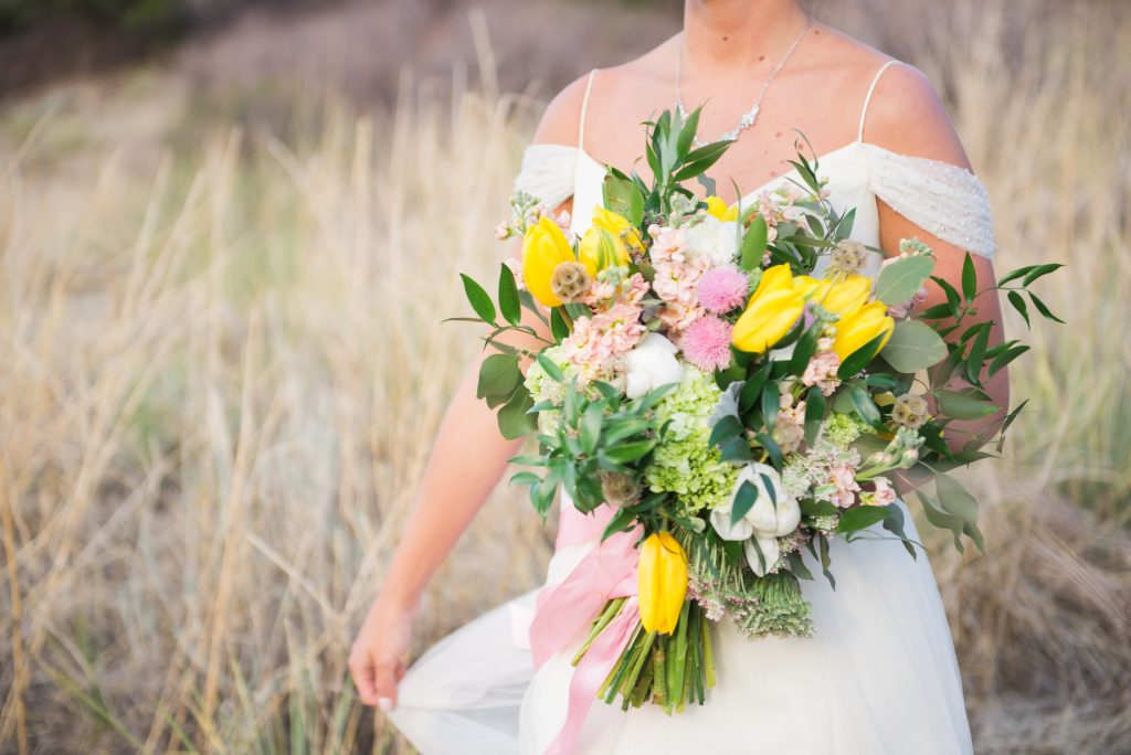 wildflower wedding inspiration, boho wedding inspiration, boho bride photos, sunflower wedding inspiration, bright wedding flowers, gorgeous wedding dress, white wedding dress, fingertip veil, indie wedding ideas, finger lakes wedding photos, finger lakes wedding ideas, vineyard wedding, bristol harbour wedding, wedding at bristol harbour, wedding photos on a lake, bridal portraits, low back wedding dress, wildflowers, pink and yellow wedding flowers, large bridal bouquet, bridal bouquet ideas, blush and yellow wedding flowers