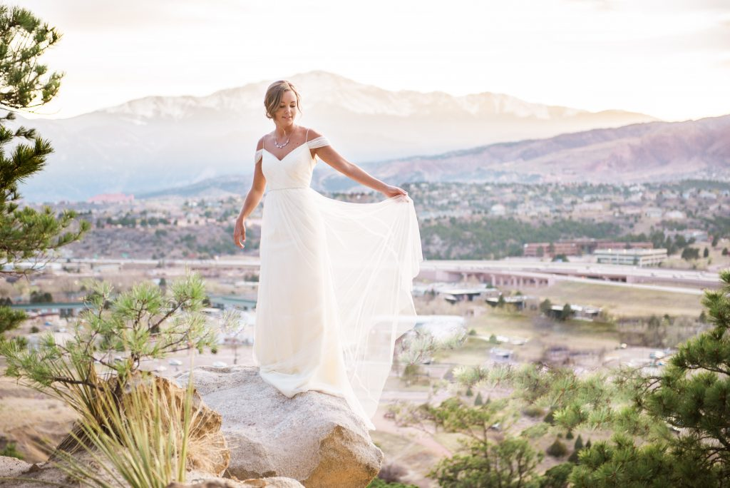 wildflower wedding inspiration, boho wedding inspiration, boho bride photos, sunflower wedding inspiration, bright wedding flowers, gorgeous wedding dress, white wedding dress, indie wedding ideas, wedding photos on a mountain, bridal portraits, low back wedding dress, wildflowers, pink and yellow wedding flowers, large bridal bouquet, bridal bouquet ideas, mountain bridal photos, pikes peak bridal photos, sheer wedding dress, shoulder strap wedding dress, loose straps wedding dress