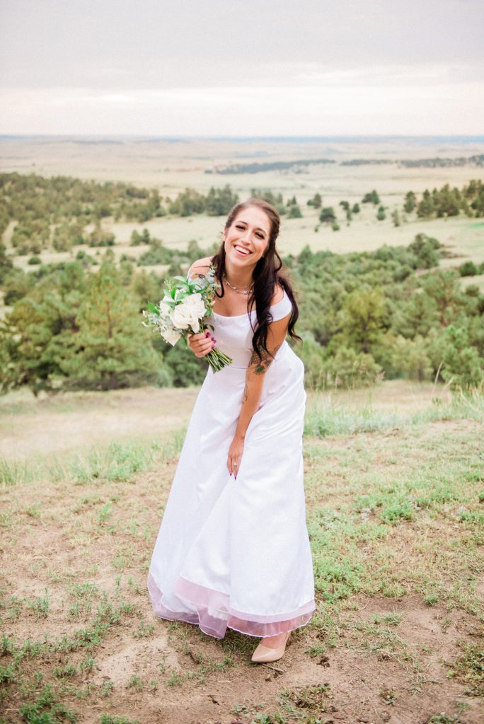 farmhouse wedding, rustic barn wedding, mountainside wedding photography, kiowa colorado wedding photography, once upon a wedding venue, colorado boho wedding photography, colorado boho wedding, allison ranslow photography, adventure wedding photography, colorado adventure wedding photography, colorado adventure elopement photography, boho bridal details, classic wedding gown, simple wedding florals, simple wedding dress, bridal veil, cathedral length bridal veil, cathedral veil, tatted bride