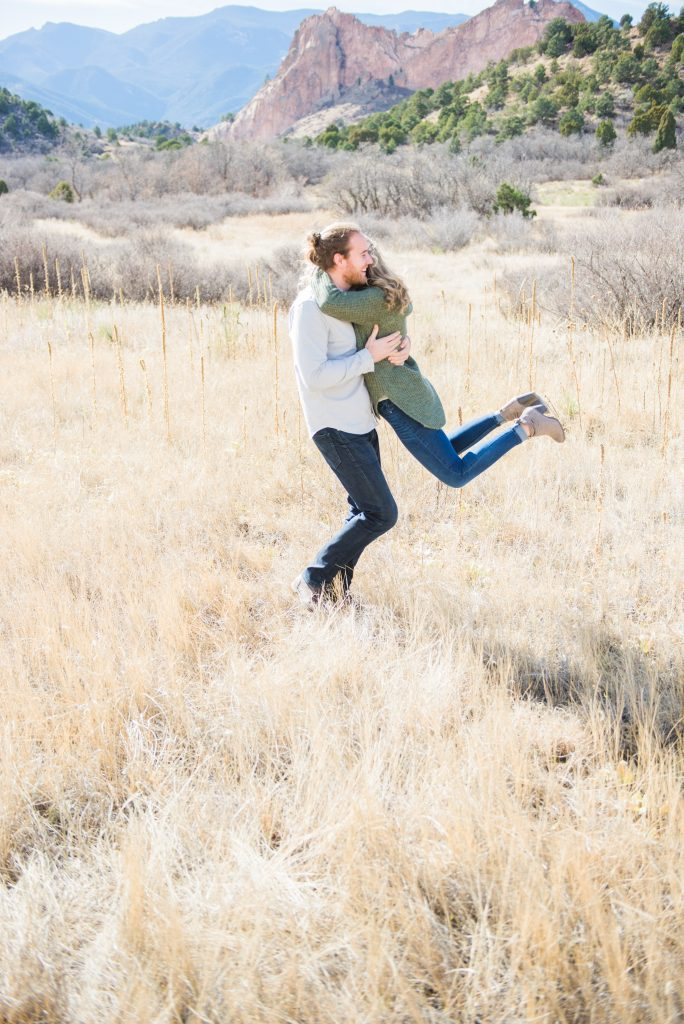 Colorado springs engagement session, Garden of the Gods engagement session, garden of the gods engagement photographer, colorado engagement photographer, colorado mountain engagement session, colorado engagement session, mountain engagement outfits, engagement session outfits, colorado wedding photographer, colorado springs, garden of the gods, mountain engagement, plaid shirt engagement session, pink sweater engagement session